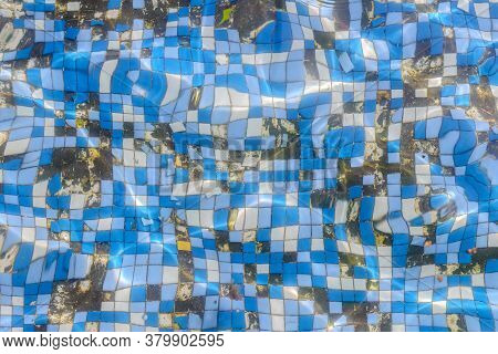 Old Damaged Small Tiles On The Bottom Of The Swimming Pool, Top View Through The Water, Background,