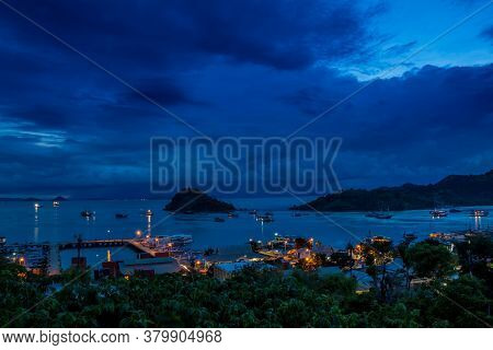 Hill Top View Over Labuan Bajo Harbour In The Evening At Twilight, Flores, Indonesia