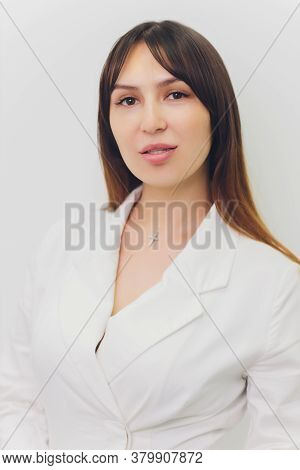 Dental Assistant In Exam Room Smiling Young Woman Dentist Portrait.