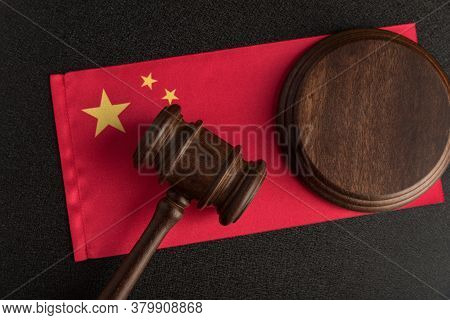Judge Gavel On The China Flag. Law And Legality In Prc. Violation Of Human Rights.