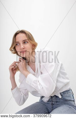 Portrait Of Young Smiling Caucasian Woman With Long Hair Posing In Shirt, Blue Jeans, Isolated On Wh