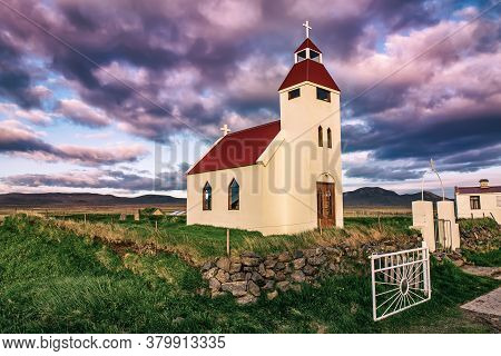 Typical Iceland Wooden Church At Sunset In Small Village, In The Northern Iceland, Scandinavia