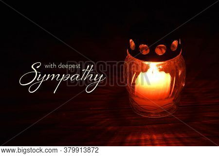 Sympathy Card With Votive Candle On Dark Background