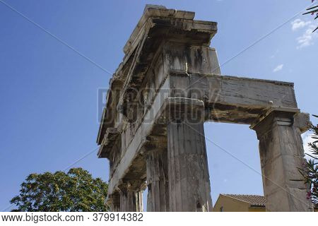Athens, Greece - August 13 2016: Ruins Of Adrian Library And The Sky In Athens