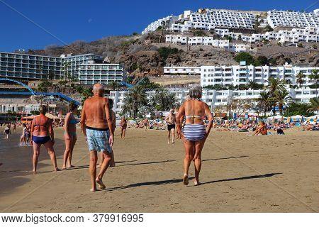 Gran Canaria, Spain - December 2, 2015: Seniors Visit Puerto Rico Beach In Gran Canaria, Spain. Cana