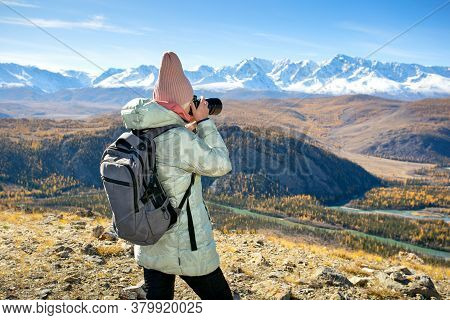 Nature Photographer Taking Pictures Outdoors During Hiking Trip At Mountain.