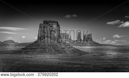 Black And White Photo Of The Sandstone Formations Of Merrick Butte And East Mitten Butte In The Dese