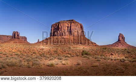 The Towering Red Sandstone Formations Of West Mitten Butte, Merrick Butte, East Mitten Buttes In  Mo