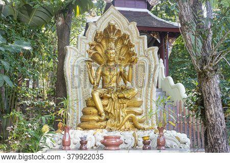 Phayao, Thailand - Dec 1, 2019: Gold Narayana Or Narayan Statue And Cobra With Natural Light In Anal
