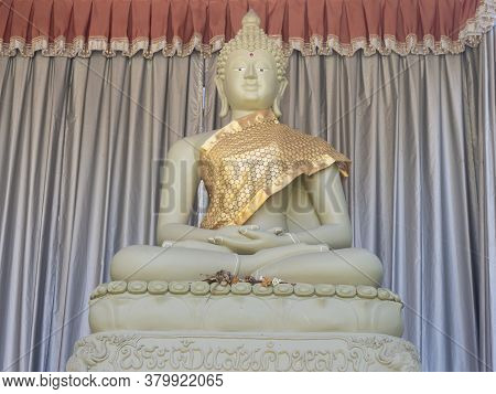 Phayao, Thailand - Dec 1, 2019: Green Buddha Statue And Dry Flower On Curtain Background In Analayo