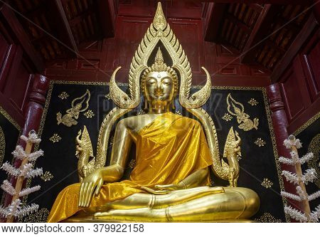Phayao, Thailand - Dec 8, 2019: Gold Buddha Statue In Wood Pagoda Or Stupa In Zoom View On Thai Art