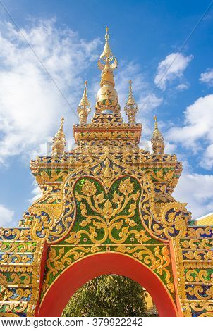 Phayao, Thailand - Dec 31, 2019: Front Gold Pagoda Or Stupa Entrance Door On Blue Sky Background In