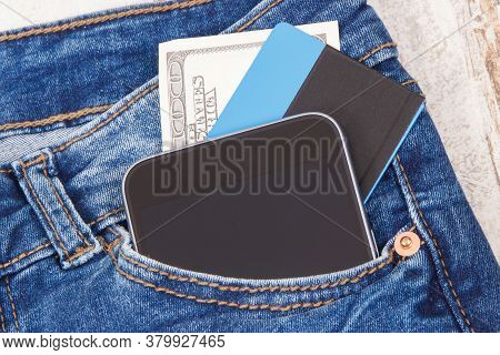 Credit Card, Currencies Dollar And Smartphone In Front Jeans Pocket. Concept Of Cashless Or Cash Pay