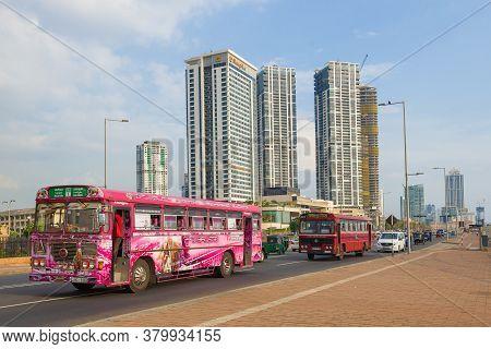 Colombo, Sri Lanka - February 21, 2020: Sri Lankan Buses Against The Background Of The Modern High-r