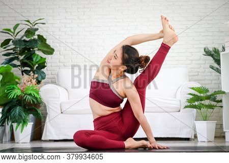 Fitness Women Doing Yoga, Difficult Postures In The White Living Room At Home. Healthy Exercise Conc