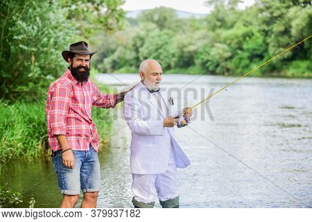Fish With Companion Who Can Offer Help In Emergency. Fishing Skills. Men Friends Relaxing Nature Bac