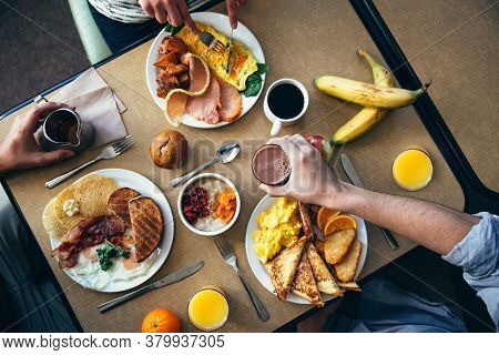 Group Of Friends Drinking Beer And Eating Snacks On Wooden Background, Overhead View Of Family Meal,