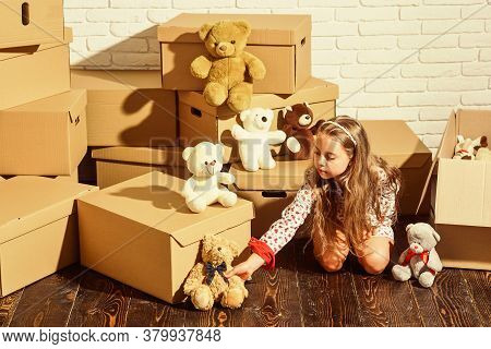 Great Location. Playing Into New Home. New Apartment. Happy Child Cardboard Box. Happy Little Girl W