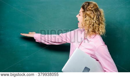 School Lecturer Explaining Topic. Woman Adorable Teacher Hold Laptop Stand Near Chalkboard. Software
