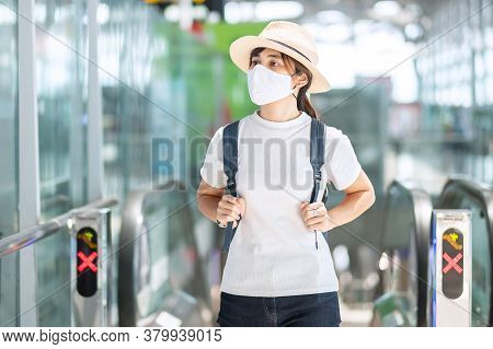 Young Adult Female Wearing Face Mask In Airport Terminal, Protection Coronavirus Disease Infection,