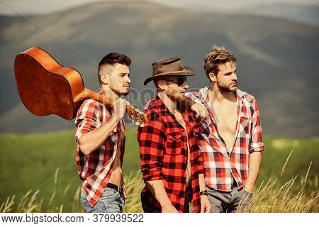 Long Route. Adventurers Squad. Tourists Hiking Concept. Hiking With Friends. Men With Guitar Hiking