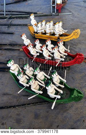 Hoi An, Vietnam, February 24, 2020: Water Puppets Representing Different Colored Rowboats From The H