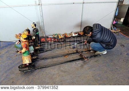 Hoi An, Vietnam, February 24, 2020: A Technician Fixes The Water Puppet Handling System Of The Hoi A