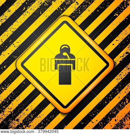 Black Gives Lecture Icon Isolated On Yellow Background. Stand Near Podium. Speak Into Microphone. Th