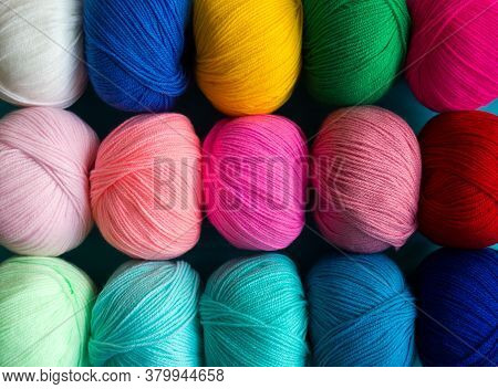 Colorful Multicolored Background From Skeins Of Acrylic Yarn. Textile Industry. Arranged Balls  Of Y