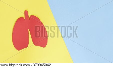 Silhouette Of Red Paper Lungs On Yellow Background. Lung Health Therapy Medical Concept. Concept Of
