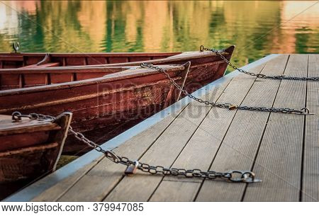 Boat Chains On The Dock, Close Up Of Boat Chains, Two Wooden Boats On The Dock, Rope Knots On The Te