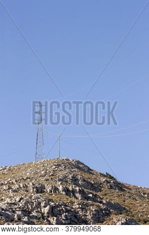 A View Of An Electricity Pylon In Italy. A Pylon Is A High Structure, Used To Support An Overhead Po