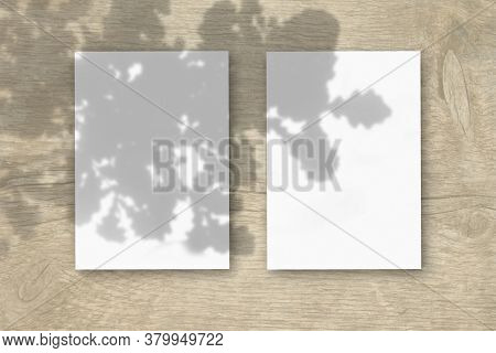 2 Vertical Sheets Of Textured White Paper On Wooden Table Background. Mockup Overlay With The Plant