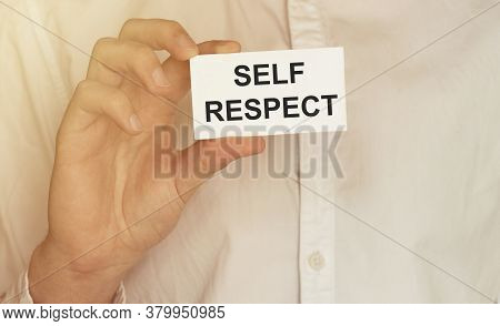 Man Take A Paper With Text Self Respect On The Shirt