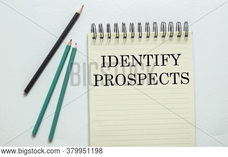 Two Green One Black Pencil With Text Identify Prospects In The Notebook On The White Background