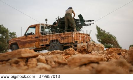Aleppo, Syria 12 March 2017:\nsoldiers Stands On An Armored Vehicle Weapon And Targets With The Arti