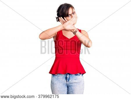 Beautiful young woman with short hair wearing casual style with sleeveless shirt rejection expression crossing arms and palms doing negative sign, angry face