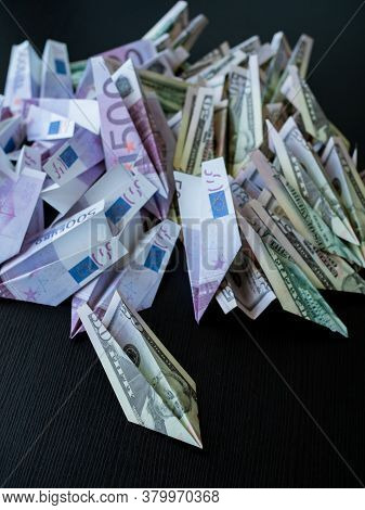 Cash Flow, Concept. A Large Pile Of Paper Planes Made From Cash, Dollars And Euros. Investments And