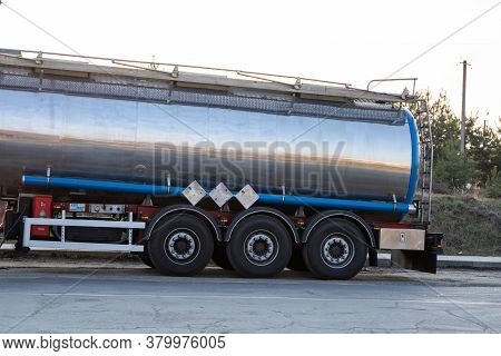 Ukraine, Kyiv - May 10, 2020: Big Fuel Gas Tanker Truck On Highway In A Sunset. Transportation And L