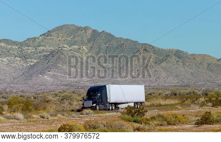 New Mexico Nm Usa - March 14, 2020: Side View Of Bright Big Rig Semi Truck Fleet Transporting Cargo