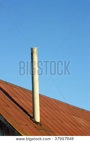 Chimney On An Old Tinny Roof