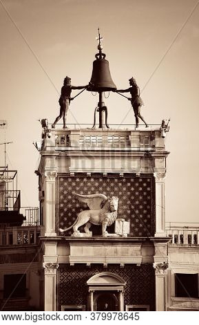 Bell and bronz statue atop of Piazza San Marco in Venice, Italy.