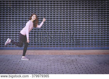 Jogging Woman. Red Haired Girl Is Pretending As She Is Jogging Showing Us Thumb Up Sign