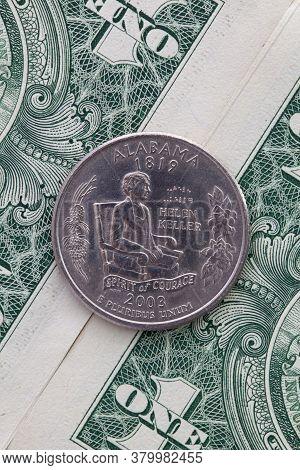 A Quarter Of Alabama On Us Dollar Bills. Symmetric Composition Of Us Dollar Bills And A Quarter Of A