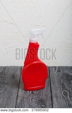 Red Plastic Bottle With Spray. Cleaning Spray.