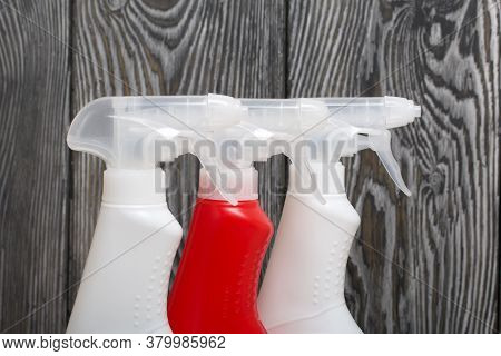 Plastic Bottles Of White And Red Color With A Spray Gun. Cleaning Spray. Against A Background Of Pai