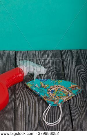 Red Plastic Bottle With Spray. Cleaning Spray. Face Mask To Protect Against The Virus.
