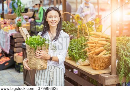 Brunette Middle Age Slim Atractive Housewife Buying Fruits And Vegetables In A Market On A Sunny Mor