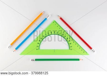 Triangular Ruler For Studying At School Isolated On A White Background
