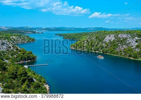 View From The Sibenik Bridge To The Canyon Krka River Towards Adriatic Sea . Bird View, Sky With Clo